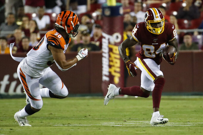 Washington Redskins wide receiver Darvin Kidsy (84) runs as he is pursued by Cincinnati Bengals outside linebacker Jordan Evans (50) during the first half of an NFL preseason football game Thursday, Aug. 15, 2019, in Landover, Md. (AP Photo/Alex Brandon)