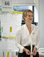 New York gubernatorial candidate Cynthia Nixon leaves a polling station after voting in the primary, Thursday Sept. 13, 2018, in New York. Democrats across New York state are picking the winner of a long and sometimes nasty primary contest between Gov. Andrew Cuomo and activist and former