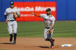 Houston Astros' second baseman Jose Altuve (27) throws to first base to complete a double play on Toronto Blue Jays' Randal Grichuk after forcing out Vladimir Guerrero Jr. at second during the seventh inning of a baseball game in Buffalo, N.Y., Saturday, June 5, 2021. (AP Photo/Joshua Bessex)