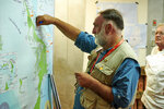 This Sept. 12, 2019 photo released by David Martensen shows chef Jose Andres plotting food delivery points on a map of the Bahamas in the World Central Kitchen headquarters kitchen on Paradise Island in Nassau, Bahamas, in the aftermath of Hurricane Dorian. Andres, who has two James Beard awards and nearly three dozen restaurants, founded the nonprofit World Central Kitchen in 2010 to respond quickly with food and water distribution after natural disasters and other emergencies around the globe. (David Martensen via AP)