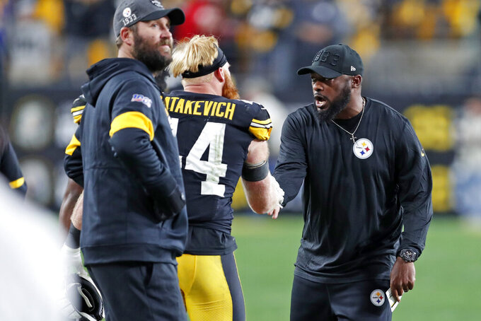 Pittsburgh Steelers head coach Mike Tomlin, right, celebrates with inside linebacker Tyler Matakevich (44) as quarterback Ben Roethlisberger, left, looks at a replay on the scoreboard during the second half of an NFL football game against the Los Angeles Rams in Pittsburgh, Sunday, Nov. 10, 2019. (AP Photo/Keith Srakocic)