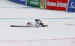 Hungary's Edit Miklos lies in the snow after crashing during an alpine ski, women's World Cup super-G, in Bad Kleinkirchheim, Austria, Saturday, Jan. 13, 2018. (AP Photo/Giovanni Auletta)