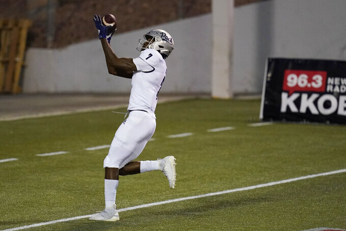 Nevada wide receiver Romeo Doubs (7) makes a touchdown catch against New Mexico during the first half of an NCAA college football game Saturday, Nov. 14, 2020, in Las Vegas. (AP Photo/John Locher)