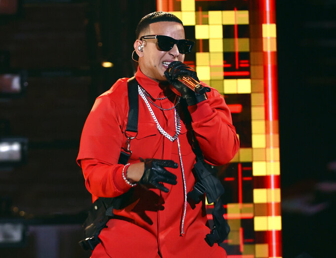 """FILE - Daddy Yankee performs at the Latin American Music Awards in Los Angeles on Oct. 17, 2019. On Friday, Dec. 6, Daddy Yankee is releasing the first of three parts of """"DY2K20,"""" a digital version of his 12 sold-out concert series """"Con Calma Pal' Choli."""" The show will air for free, in three parts, on his YouTube channel. (Photo by Chris Pizzello/Invision/AP, File)"""