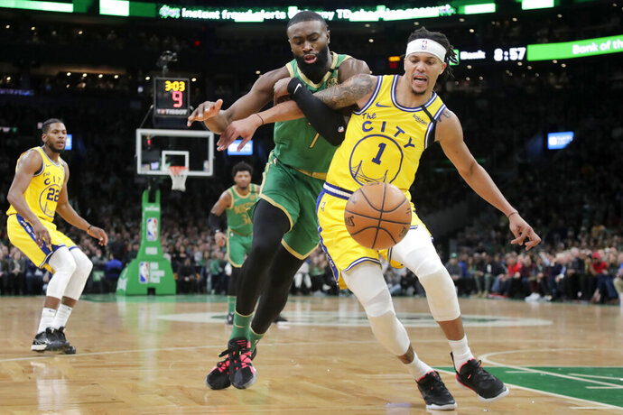 Boston Celtics guard Jaylen Brown, left, and Golden State Warriors guard Damion Lee (1) chase the ball during the second quarter of an NBA basketball game Thursday, Jan. 30, 2020, in Boston. (AP Photo/Elise Amendola)