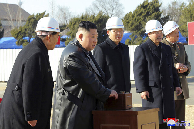 "In this Tuesday, March 17, 2020, photo provided on Wednesday, March 18, 2020, by the North Korean government, North Korean leader Kim Jong Un, center, attends the ground-breaking ceremony of a general hospital in Pyongyang in North Korea. Kim said it's ""crucial"" to improve his country's health care system during the ceremony, state media reported Wednesday, amid worries about a coronavirus outbreak in the impoverished North. Independent journalists were not given access to cover the event depicted in this image distributed by the North Korean government. The content of this image is as provided and cannot be independently verified. Korean language watermark on image as provided by source reads:"