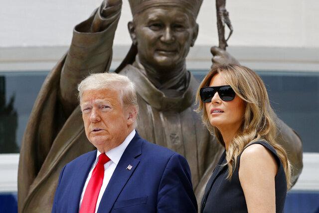 President Donald Trump and first lady Melania Trump visit Saint John Paul II National Shrine, Tuesday, June 2, 2020, in Washington. (AP Photo/Patrick Semansky)