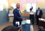 Opposition coalition Umbrella for Democratic Change presidential candidate, Duma Boko, casts his vote in Gaborone Wednesday Oct. 23, 2019. Polls opened in Botswana as the long peaceful southern African nation faces what is expected to be a tight election.(AP Photo/Sello Motseta)