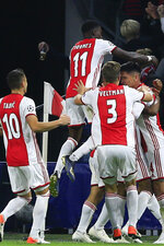 Ajax players celebrate scoring their second goal during the group H Champions League soccer match between Ajax and LOSC Lille at Johan Cruyff ArenA in Amsterdam, Netherlands, Tuesday, Sept. 17, 2019. (AP Photo/Peter Dejong)