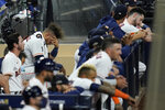 Houston Astros' Yuli Gurriel sits in the dugout during the ninth inning in Game 3 of a baseball American League Championship Series against against the Tampa Bay Rays, Tuesday, Oct. 13, 2020, in San Diego. The Rays defeated the Astros 5-2 to lead the series 3-0 games. (AP Photo/Gregory Bull)