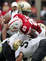 FILE - In this Sept. 8, 2018, file photo Nebraska running back Greg Bell (25) fumbles the ball for a turnover as he is hit by Colorado linebacker Nate Landman (53), defensive lineman Israel Antwine, rear, and linebacker Rick Gamboa (32) during the first half of an NCAA college football game in Lincoln, Neb. Through three games Colorado sophomore linebacker Nate Landman already has 34 tackles. That's double the total he had as a freshman last season.(AP Photo/Nati Harnik)