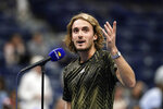 Stefanos Tsitsipas, of Greece, talks to the crowd after defeating Adrian Mannarino, of France, during the second round of the US Open tennis championships, Wednesday, Sept. 1, 2021, in New York. (AP Photo/Frank Franklin II)