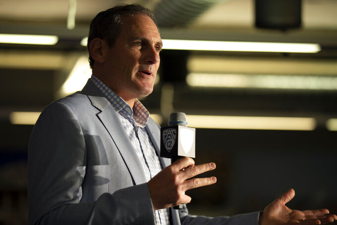 Commissioner Larry Scott speaks during the Pac-12 NCAA college basketball media day, in San Francisco, Tuesday, Oct. 8, 2019. (AP Photo/D. Ross Cameron)