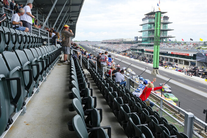 Fans watch a restart from stands during the NASCAR Brickyard 400 auto race at the Indianapolis Motor Speedway, Sunday, Sept. 8, 2019, in Indianapolis. The Speedway announced that they had sold over 50,000 seats for the race. (AP Photo/AJ Mast)