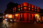 In the aftermath of Hurricane Ida, people walk across Bourbon Street, Saturday, Sept. 4, 2021, in the French Quarter of New Orleans. (AP Photo/Matt Slocum)