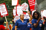 Registered nurses at the University of Chicago Medical Center (UCMC) hold a one-day strike in Chicago on Friday, Sept. 20, 2019.   Nurses are holding a one-day strike following what they call a breakdown of contract negotiations between their union and the hospital.    (Jose M. Osorio /Chicago Tribune via AP)