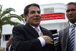 FILE - In this Oct.25, 2009 file photo Tunisian President Zine El Abidine Ben Ali salutes his supporters in the affluent Carthage neighborhood next to the capital, Tunis.Tunisia's autocratic ruler Zine El Abidine Ben Ali, toppled in 2011, died in exile in Saudi Arabia. (AP Photo/Alfred de Montesquiou, File)