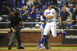 New York Mets' Brandon Nimmo scores on a three-run double pinch hit by Rajai Davis during the eighth inning of a baseball game against the Los Angeles Dodgers, Saturday, Sept. 14, 2019, in New York. (AP Photo/Mary Altaffer)