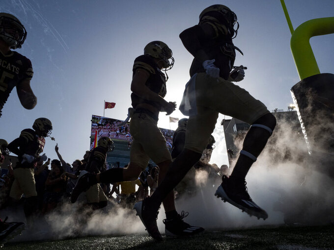 Texas State players run onto the field before an NCAA college football game against Baylor, Saturday, Sept. 4, 2021, in San Marcos, Texas. Baylor won 29-20. (AP Photo/Michael Thomas)