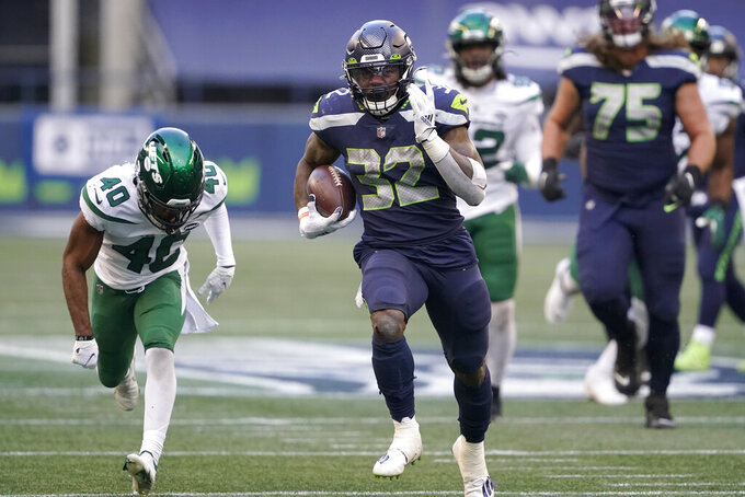 Seattle Seahawks running back Chris Carson carries against the New York Jets during the second half of an NFL football game, Sunday, Dec. 13, 2020, in Seattle. (AP Photo/Ted S. Warren)