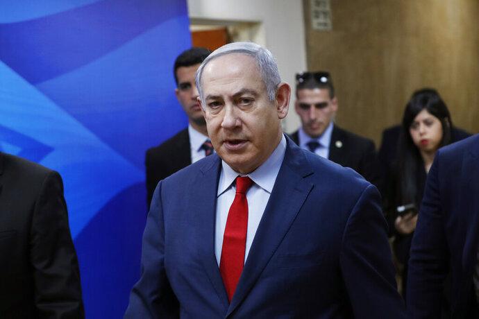 Israeli Prime Minister Benjamin Netanyahu arrives for the weekly cabinet meeting in Jerusalem, Sunday, Jan. 5, 2020. (Ronen Zvulun/Pool via AP)