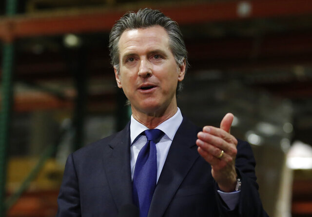 FILE - California Gov. Gavin Newsom gestures during an update June 26, 2020, in Rancho Cordova, Calif., on the coronavirus pandemic. Newsom said Monday, July 27, 2020, the state will spend $52 million to tackle the outbreak in eight Central Valley counties. He said the money will go toward helping improving isolation, quarantine, and testing policies and to helping health care workers. (AP Photo/Rich Pedroncelli, Pool, File)