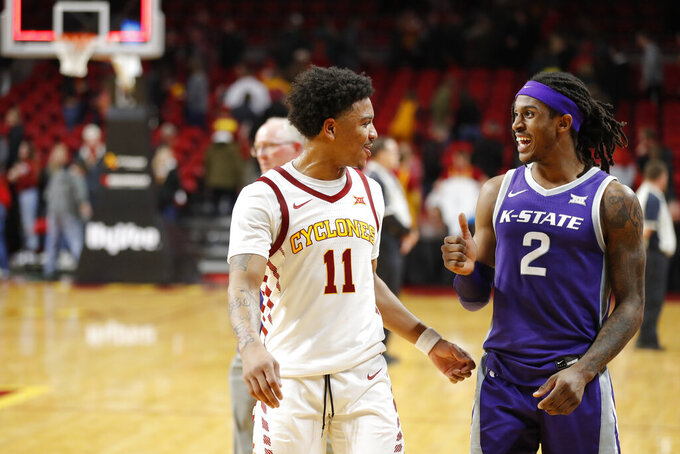 Iowa State guard Prentiss Nixon, left, and Kansas State guard Cartier Diarra laugh as they walk off the court following Iowa State's 73-63 win over Kansas State in an NCAA college basketball game Saturday, Feb. 8, 2020, in Ames, Iowa. (AP Photo/Matthew Putney)