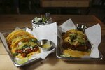 In this Friday, Oct. 18, 2019 photo is two of the taco selections at the Earth Plant Based Cuisine restaurant in Phoenix. No longer just a few items on a mainstream restaurant's menu, vegan Mexican food has become a widening industry on its own with Latinos taking control of the kitchen. (AP Photo/Ross D. Franklin)