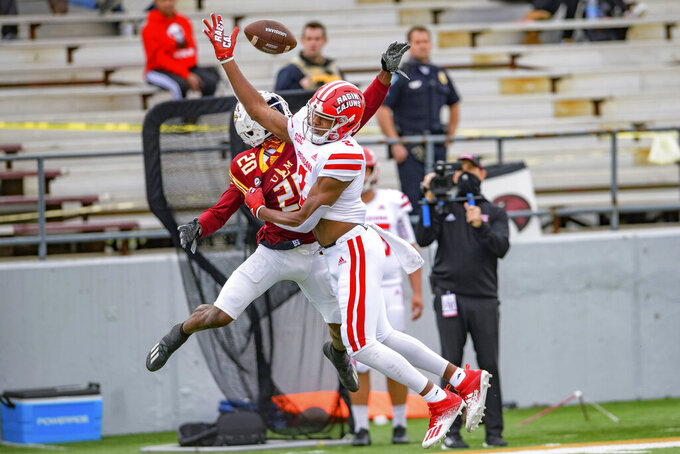Louisiana-Lafayette wide receiver Kyren Lacy (2) can't make a catch against Louisiana-Monroe cornerback Josh Newton (20) during the first half of an NCAA college football game in Monroe, La., Saturday, Nov. 28, 2020. (AP Photo/Matthew Hinton)