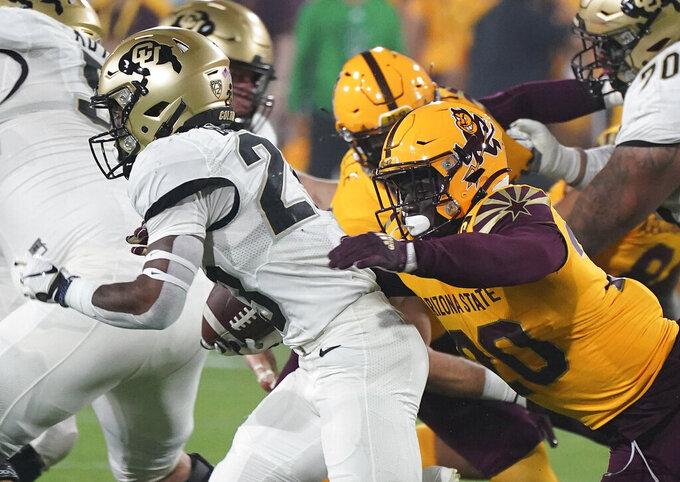 Arizona State linebacker Darien Butler (20) wraps up Colorado State tailback Jarek Broussard (23) from behind during the first half of an NCAA college football game Sat, Sept 25, 2021, in Tempe, Ariz. (AP Photo/Darryl Webb)