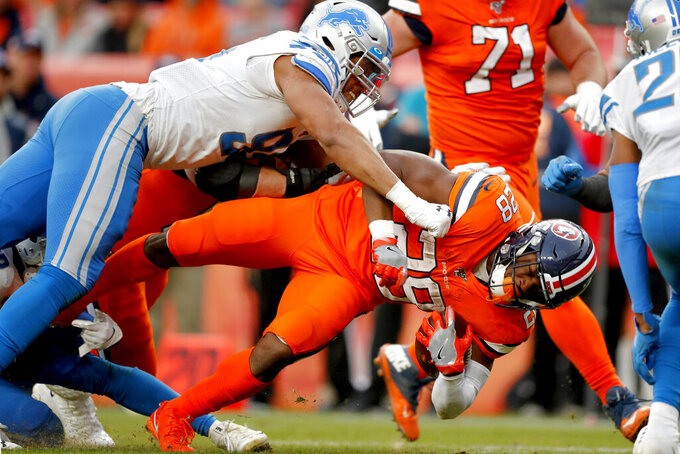 Detroit Lions defensive end Romeo Okwara tackles Denver Broncos running back Royce Freeman (28) during the second half of an NFL football game, Sunday, Dec. 22, 2019, in Denver. (AP Photo/David Zalubowski)