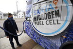 Kevin Baker, a maintenance technician, refuels a hydrogen fuel cell bus, Tuesday, March 16, 2021, in Canton, Ohio. Hydrogen, the most abundant element in the universe, is increasingly viewed as a vital answer to troubling questions about how to slow the catastrophic effects of climate change attributed to the planet's 1.2 billion cars and trucks, nearly all of which burn gasoline and diesel. (AP Photo/Tony Dejak)