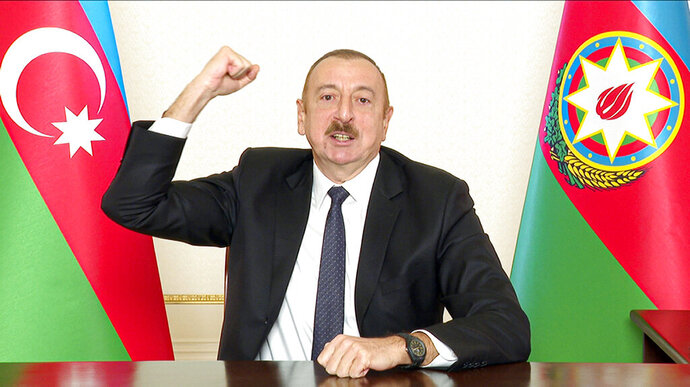 In this photo provided on Wednesday, Nov. 25, 2020, by the Azerbaijan's Presidential Press Office, Azerbaijani President Ilham Aliyev gestures as he addresses the nation in Baku, Azerbaijan. The Azerbaijani army has entered the Kalbajar region, one more territory ceded by Armenian forces in a truce that ended deadly fighting over the separatist territory of Nagorno-Karabakh. (Azerbaijani Presidential Press Office via AP)