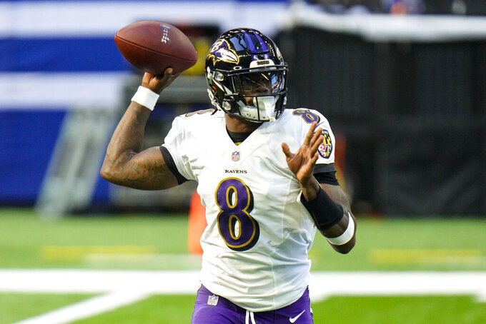 Baltimore Ravens quarterback Lamar Jackson (8) throw against the Indianapolis Colts in the first half of an NFL football game in Indianapolis, Sunday, Nov. 8, 2020. (AP Photo/AJ Mast)