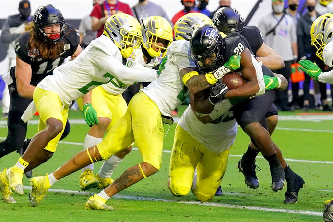 Iowa State running back Breece Hall (28) scores a touchdown as Oregon safety Nick Pickett defends during the first half of the Fiesta Bowl NCAA college football game, Saturday, Jan. 2, 2021, in Glendale, Ariz. (AP Photo/Rick Scuteri)