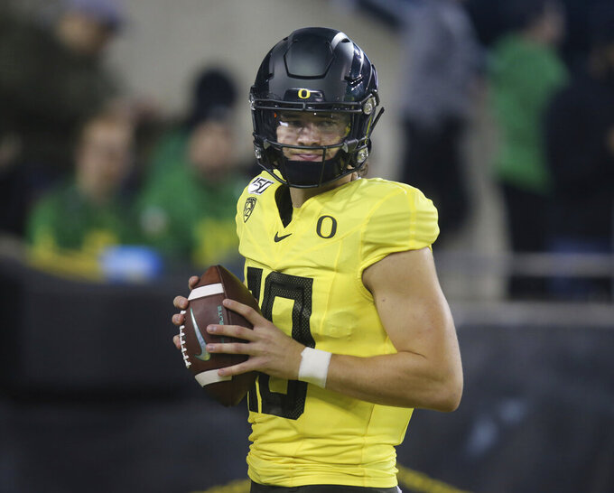 Oregon quarterback Justin Herbert warms up before an NCAA college football game against Arizona, Saturday, Nov. 16, 2019, in Eugene, Ore. (AP Photo/Chris Pietsch)