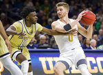 Notre Dame's Rex Pflueger (0) gets pressure from Georgia Tech's Bubba Parham (11) during the second half of an NCAA college basketball game Saturday, Feb. 1, 2020, in South Bend, Ind. Notre Dame won 72-80. (AP Photo/Robert Franklin)