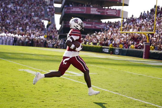 South Carolina defensive back David Spaulding (29) runs in for a touchdown after an interception for a pick six in the first half of an NCAA college football game against Troy, Saturday, Oct. 2, 2021, in Columbia, S.C. (AP Photo/Brynn Anderson)