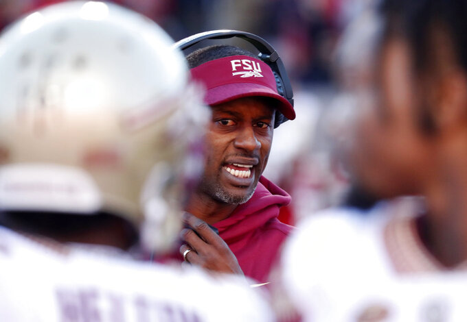 Florida State head coach Willie Taggart directs his players during the first half of an NCAA college football game against North Carolina State in Raleigh, N.C., Saturday, Nov. 3, 2018. (AP Photo/Chris Seward)