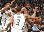 Toronto Raptors' Kawhi Leonard looks to pass during the second half of Game 5 of the NBA Eastern Conference basketball playoff finals against the Milwaukee Bucks Thursday, May 23, 2019, in Milwaukee. The Raptors won 105-99 to take a 3-2 lead in the series. (AP Photo/Morry Gash)