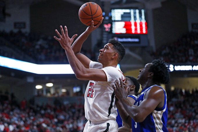 Texas Tech's TJ Holyfield (22) shoots the ball around Eastern Illinois' Mack Smith (3) during the first half of an NCAA college basketball game Tuesday, Nov. 5, 2019, in Lubbock, Texas. (AP Photo/Brad Tollefson)