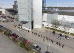 People queue to receive a dose of a  COVID-19 vaccine, outside the Stockholmsmassan exhibition center turned mass vaccination center, in Stockholm, Sweden, Thursday April 8, 2021. (Fredrik Sandberg/TT News Agency via AP)