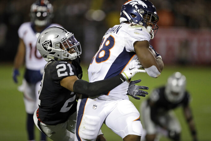 Denver Broncos running back Royce Freeman runs with the ball past Oakland Raiders cornerback Gareon Conley (21) during the second half of an NFL football game Monday, Sept. 9, 2019, in Oakland, Calif. (AP Photo/Ben Margot)