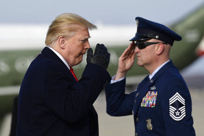 President Donald Trump salutes as he walks up the steps of Air Force One at Andrews Air Force Base in Md., Saturday, Dec. 8, 2018. Trump is heading to the Army-Navy football game in Philadelphia. (AP Photo/Susan Walsh)