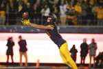 West Virginia wide receiver David Sills V (13) just misses a pass during the first half of an NCAA college football game against Baylor, Thursday, Oct. 25, 2018, in Morgantown, W.Va. (AP Photo/Raymond Thompson)
