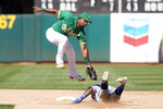 Texas Rangers' Yonny Hernandez, right, steals second base against Oakland Athletics shortstop Elvis Andrus during the sixth inning of a baseball game in Oakland, Calif., Sunday, Sept. 12, 2021. (AP Photo/Jeff Chiu)