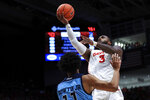 Rhode Island's Jeff Dowtin defends as Dayton's Trey Landers drives to the basket during the first half of an NCAA college basketball game, Tuesday, Feb. 11, 2020, in Dayton, Ohio. (AP Photo/Aaron Doster)