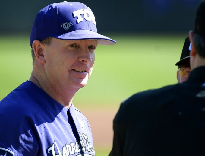 FILE - TCU coach Jim Schlossnagle talks to the umpires before the team's NCAA college baseball game against UC Irvine in Fort Worth, Texas, in this Saturday, March 3, 2018, file photo. Texas A&M has hired Jim Schlossnagle as its new baseball coach. He goes to the Aggies after 18 seasons at TCU that included five trips to the College World Series.  (Max Faulkner/Star-Telegram via AP, File)
