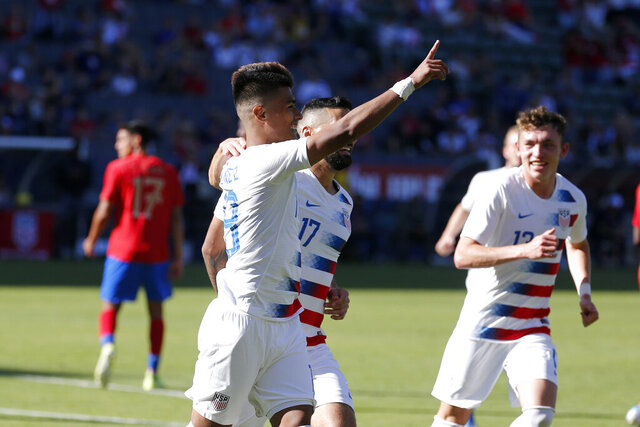 United States forward Ulysses Llanez, left, celebrates after scoring a goal against Costa Rica during the second half of an international friendly soccer match in Carson, Calif., Saturday, Feb. 1, 2020. The U.S. won 1-0. (AP Photo/Ringo H.W. Chiu)