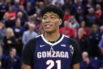 Washington Wizards' Rui Hachimura, who played at Gonzaga, stands on the court during the school's senior night activities before an NCAA college basketball game against Saint Mary's in Spokane, Wash., Saturday, Feb. 29, 2020. (AP Photo/Young Kwak)